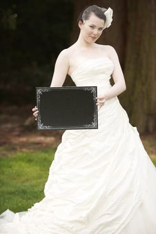 Bride And Blank Board Stock Photography