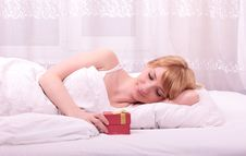 Cute Woman Lying On Bed Royalty Free Stock Photo