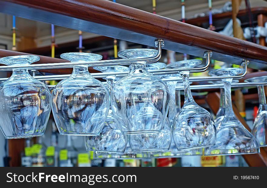 Goblets hanging on rack of the bar