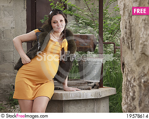 A pregnant woman is resting in the garden free stock for Gardening while pregnant