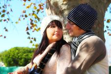 Couple Gazing At Each Other On Park Bench Stock Image