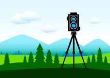 Free Camera In Green Landscape Stock Photo - 19576100