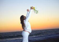 Free Pregnant Woman At The Beach During Sunset Stock Photo - 19579950