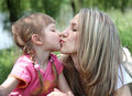 Free Little Girl Kissing Her Mother In  Park Stock Photo - 19584670