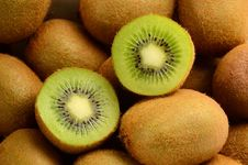 Kiwi And Two Kiwi Share Royalty Free Stock Photography