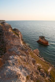 Sunken Ship Near The Rocky Shore Royalty Free Stock Photography