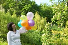 Free Happy Woman With Color Balloons Royalty Free Stock Photos - 19587828