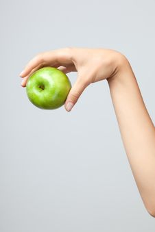 Free Hand Holding Apple. Stock Image - 19588801