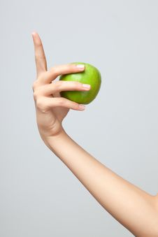 Free Hand Holding Apple. Stock Images - 19588804