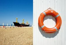 Freighter And Life Preserver Stock Photo