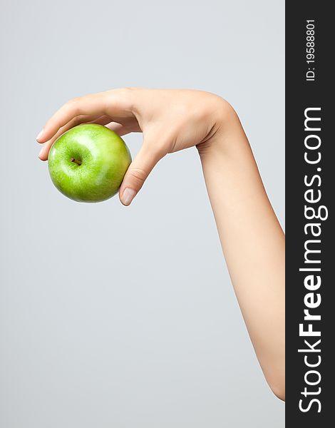 Hand holding apple.