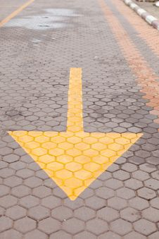 Yellow Arrow On The Ground Royalty Free Stock Photos