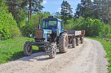Tractor On Forest Road Royalty Free Stock Photography