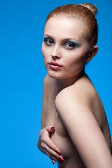 Portrait Of Nude Young Woman On Blue Royalty Free Stock Images