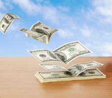 Flaying Dollars Stock Images