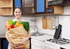 Free Young Beautiful Caucasian Woman In The Kitchen Stock Photography - 19594262