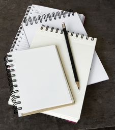 Four Notebook Overlapping Royalty Free Stock Photo