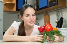 Free Young Beautiful Caucasian Woman In The Kitchen Stock Image - 19594451
