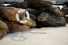 Free Lifebuoy Hangs On A Stick On The Beach Stock Photography - 19599622