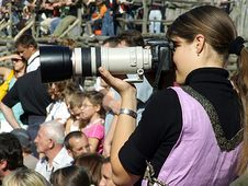 Girl With Camera Stock Images