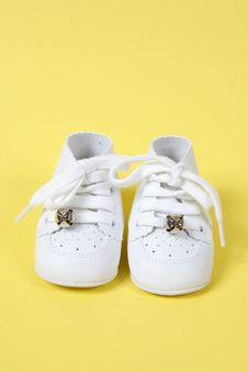 Free Baby Shoes Together On Yellow Royalty Free Stock Images - 1964769