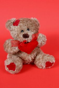 Free Teddy Bear On Red Background Stock Photography - 1964982