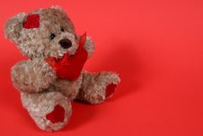 Free Small Teddy Bear On Red Background Stock Photos - 1965013
