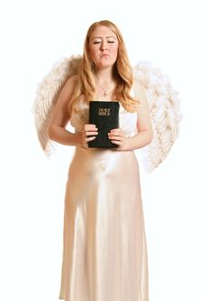 Free Goddess Angel Holding Bible With Closed Eye Royalty Free Stock Photos - 1966438