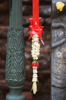 Free Flowers And Ribbon Hanging On A Temple Alter In Thailand Stock Photos - 1967083
