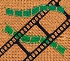 Free Film Strip On Brown Texture Stock Image - 1968231