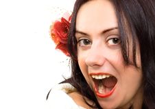 Excited Brunette Girl With Flower In Hair Royalty Free Stock Image