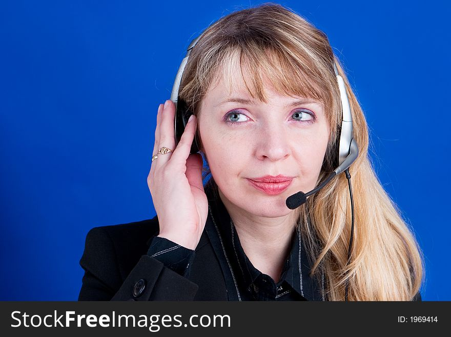 A customer representative with headset making a telephone call