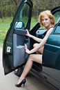 Free A Beautiful Woman Is Sitting In A Car Stock Photo - 19608510