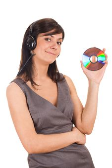 Free Young Lady Holding CD And Listening To Music Royalty Free Stock Photo - 19601275