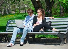 Free Couple Using Laptop Outdoors Stock Photo - 19601640