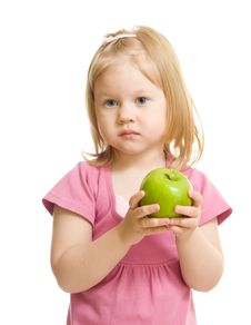 Little Girl Portrait Eating Green Apple Isolated Royalty Free Stock Image