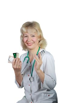 The Woman , Doctor Shows Medicines And Smiles Royalty Free Stock Photo