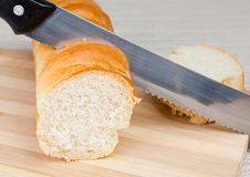 Loaf Of Homemade Bread And A Slice On A Wooden Br Royalty Free Stock Photos