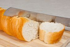 Loaf Of Homemade Bread And A Slice On A Wooden Bre Royalty Free Stock Images