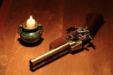 Ancient Pistol And Candle Royalty Free Stock Photography