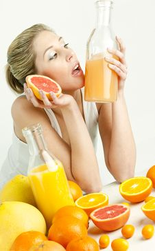 Woman With Citrus Fruit Stock Photography