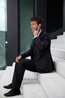 Free Business Man Siting On Stairs Royalty Free Stock Photos - 19609878