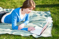 Free Beautiful Girl Working On Laptop In The Park Royalty Free Stock Photos - 19615448