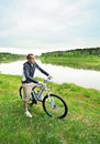 Free Young Man On A Bicycle Royalty Free Stock Photo - 19615605