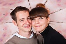 Free A Couple Under An Umbrella Royalty Free Stock Images - 19611289