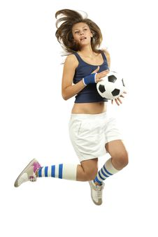 Girl Jumpig With Soccer Ball Stock Photography