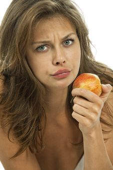 Embarrassed Woman With An Apple Royalty Free Stock Photo