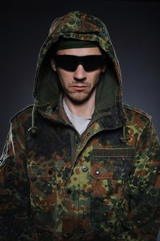 Soldier In Camouflage And Ammunition Stock Photography