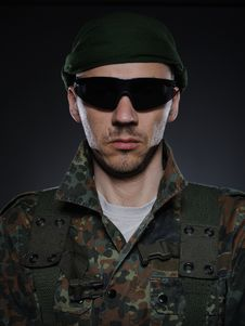 Soldier In Camouflage And Ammunition Royalty Free Stock Photo