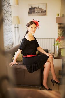 Pretty Woman Sitting On Sofa In Cafe Royalty Free Stock Photos